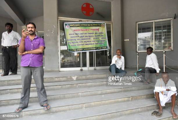 People sitting outside the closed Out Patient Department of KIMS Hospital during strike by private doctors and private medical establishments against...