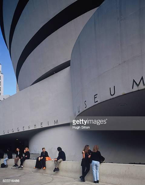 People sitting outside the Guggenheim Museum, Manhattan, New York City, USA