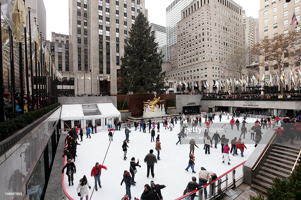 People skate beneath the Christmas tree at the Rockefeller Center ice skating rink on Christmas Eve on December 24, 2012 in New York City. Christians around the world are gearing up for Christmas festivities on December 25.