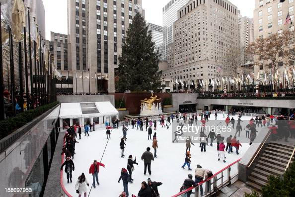 People skate beneath the Christmas tree at the Rockefeller Center ice skating rink on Christmas Eve on December 24 2012 in New York City Christians...