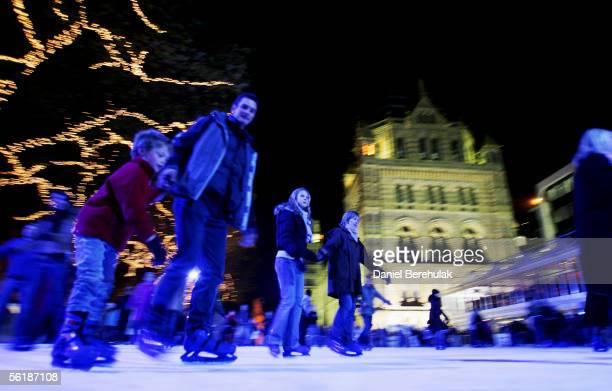 People skate during the launch of the Natural History Museum's new winter ice rink and Christmas Fair on November 16 2005 in London England The rink...