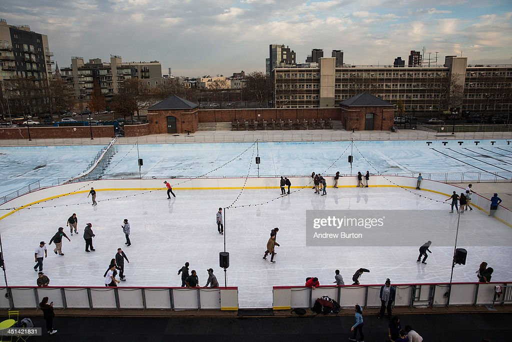 People skate on the ice rink at McCarren Pool, which opened for the winter months last week, on November 22, 2013 in the Green Point neighborhood of the Brooklyn borough of New York City. McCarren Pool originally opened in 1936, though it closed in 1984; it reopened in 2012 after a multimillion dollar remodeling. The winter ice rink was unable to open last winter due to complications; this year it is scheduled to stay open through January 5th, 2014.