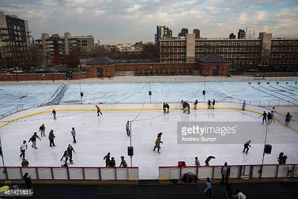 People skate on the ice rink at McCarren Pool which opened for the winter months last week on November 22 2013 in the Green Point neighborhood of the...