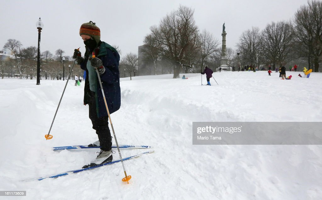 People ski and sled in Boston Common following a powerful blizzard on February 9, 2013 in Boston, Massachusetts. The storm knocked out power to 650,000 and dumped more than two feet of snow in parts of New England.