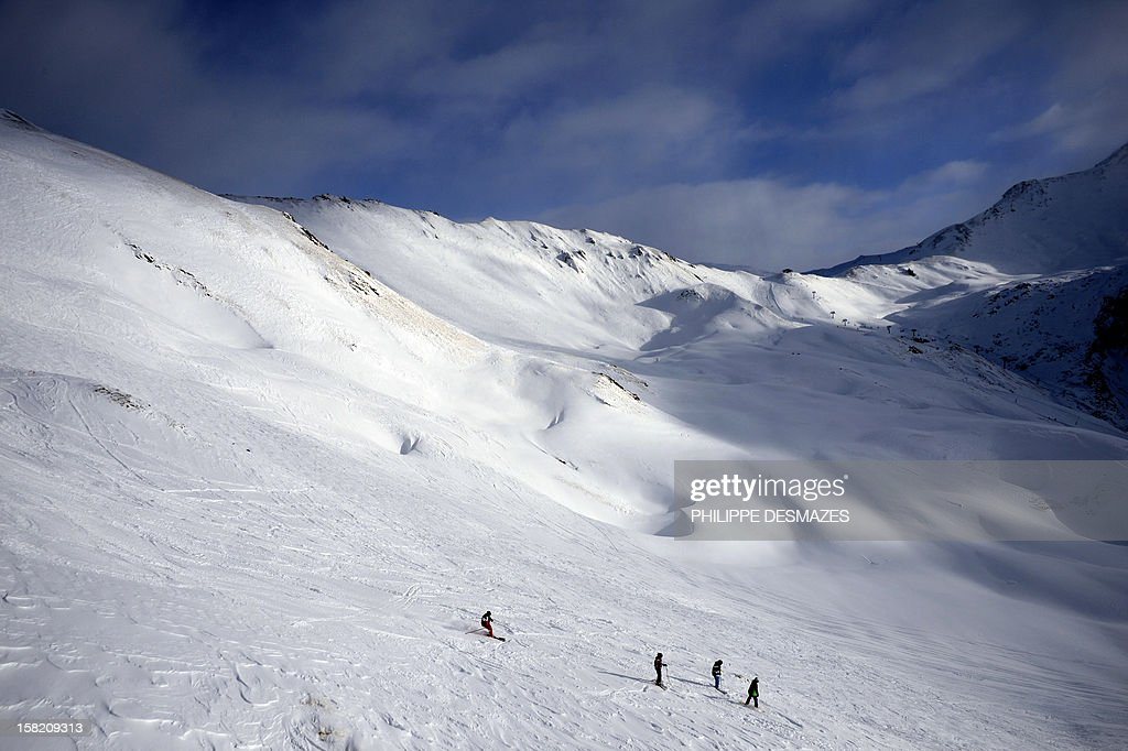 People ski off piste at Val d'Isere, in the French Alps, on December 11, 2012. Recent snowfalls have encouraged skiers to hit the slopes and the Val d'Isere authorities have opened certain slopes early.