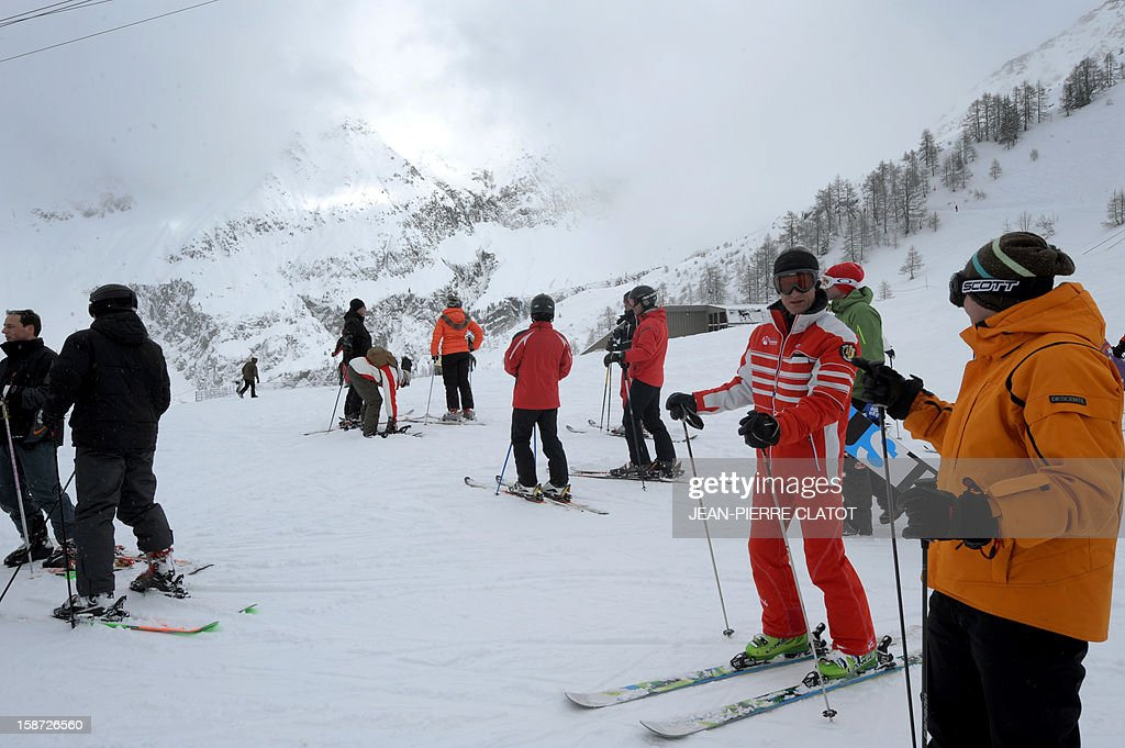 People ski on December 26, 2012 at the Grands-Montets ski area near Argentiere in the Chamonix valley. AFP PHOTO / Jean Pierre Clatot