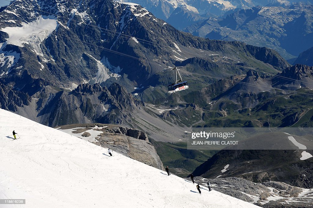 People ski on the Grande Motte glacier in the French Alps ski resort of Tignes on June 26 2011 For the summer ski season the glacier is opened from...
