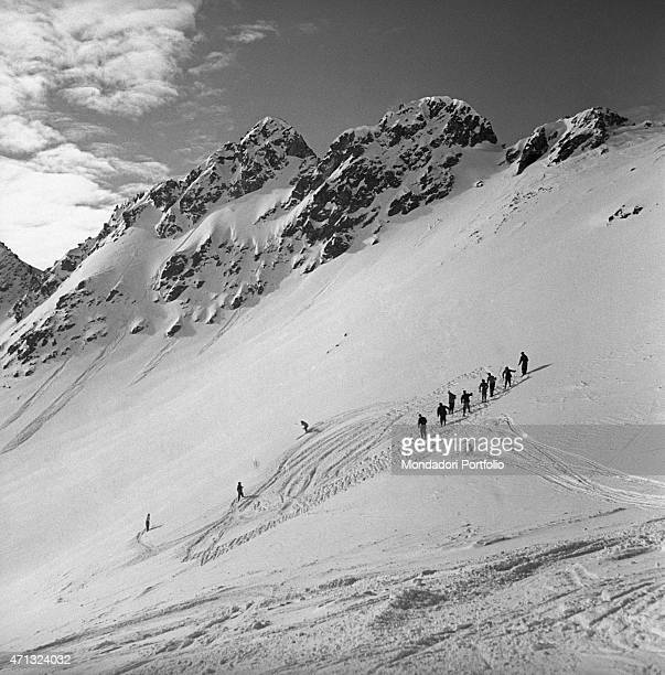 People skiing on a run in Sestriere Sestriere 1950s