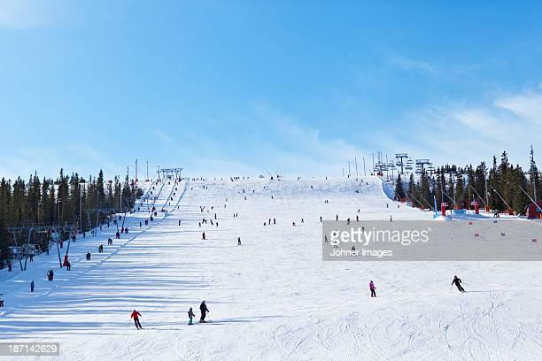People skiing on wide slope