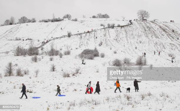 People sledging down the side of St Catherine's Hill in Winchester after heavy snowfall