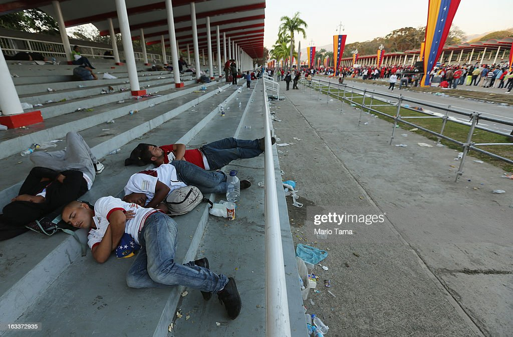 People sleep as others wait in line before the funeral for Venezuelan President Hugo Chavez outside the Military Academy on March 8, 2013 in Caracas, Venezuela. Countless Venezuelans have paid their last respects to Chavez and more than 30 heads of state were expected to attend the funeral today.