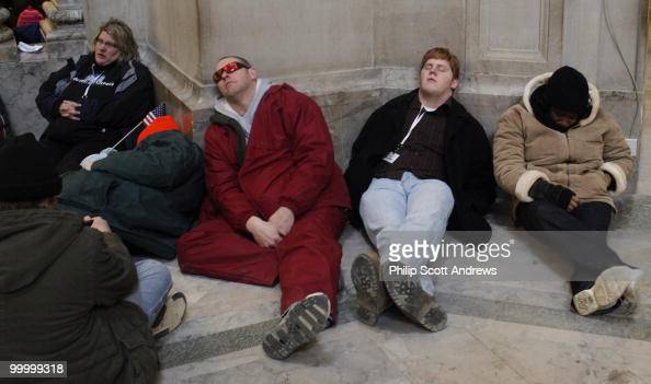 People sleep at the Natural History Museum after spending the day in subzero temperatures on the National Mall after the 56th Inauguration on January...