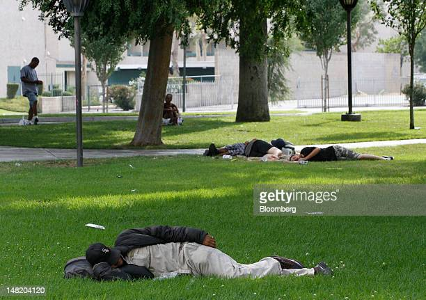 People sleep on the lawn of a public library in San Bernardino California US on Wednesday July 11 2012 San Bernardino is poised to become the first...