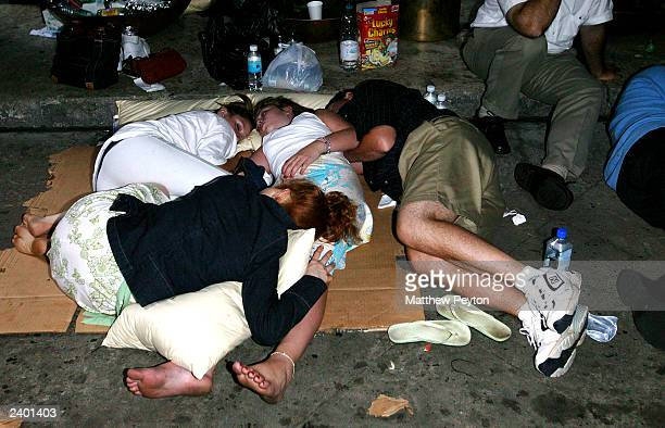People sleep outside the Marriot Marquis Hotel during the east coast blackout August 15 2003 in New York City