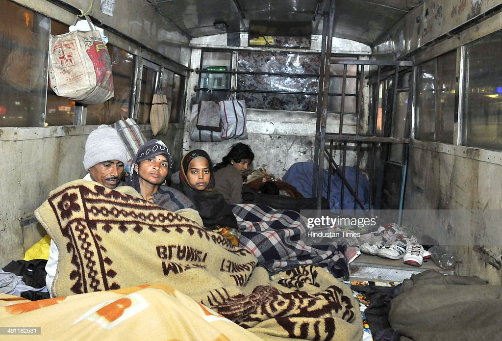 People sleeping in a bus and using it as night shelter near AIIMS Hospital arranged by an NGO on January 7 2014 in New Delhi India Aam Aadmi Party...