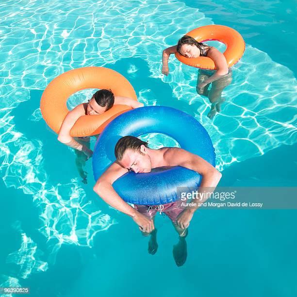 people sleeping in pool