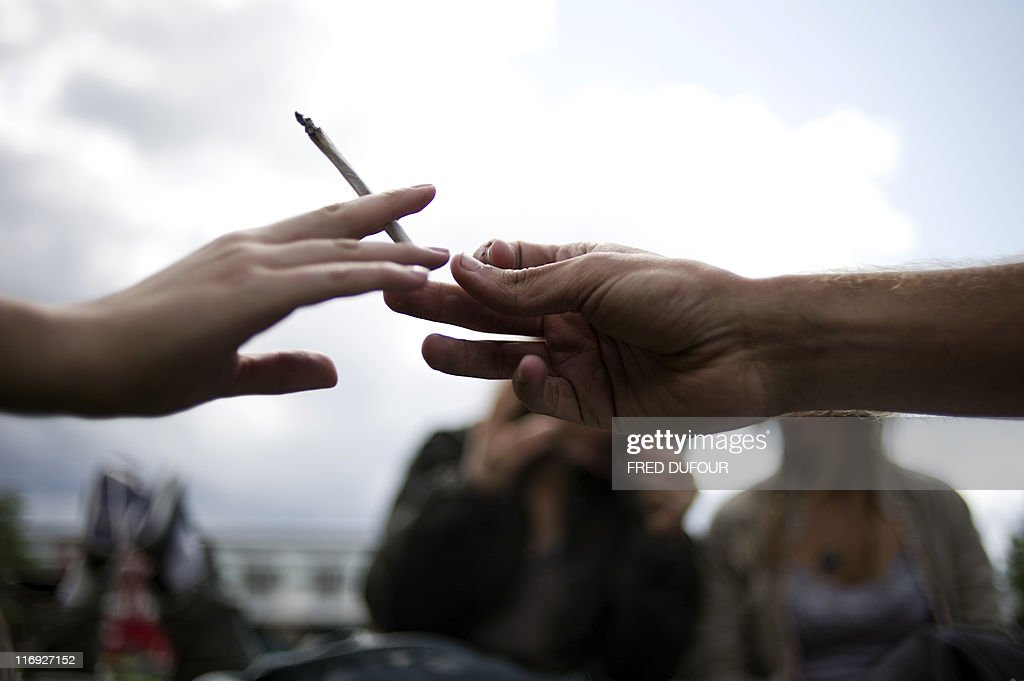 People smoke a joint during a demonstration organised by the CIRC (research and information center) and entitled 'L'appel du 18 juin' (the call of June 18) to claim for the legalization of the use of marijuana and hashish, on June 18, 2011 at the Parc de la Villette in Paris. The 'Appel du 18 Joint' uses a play on words to make their point, coming on the same day as France celebrates the 'Appel du 18 Juin' or Call of 18 June, when Charles de Gaulle called for resistance against collaborationist Vichy government in 1940. AFP PHOTO / FRED DUFOUR