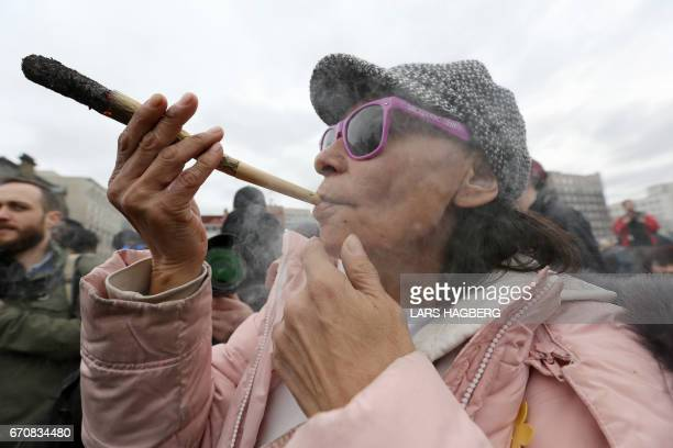 People smoke weed on Parliament Hill on 4/20 in Ottawa Ontario April 20 2017 Polling released Thursday showed strong support in Canada for a...