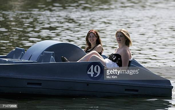 People soak up the sun as they row a boat in Hyde Park on July 18 2006 in London England