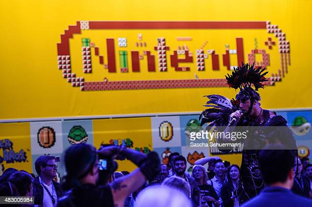 People socalled Cosplay play at the Gamescom 2015 gaming trade fair during the media day on August 5 2015 in Cologne Germany Gamescom is the world's...