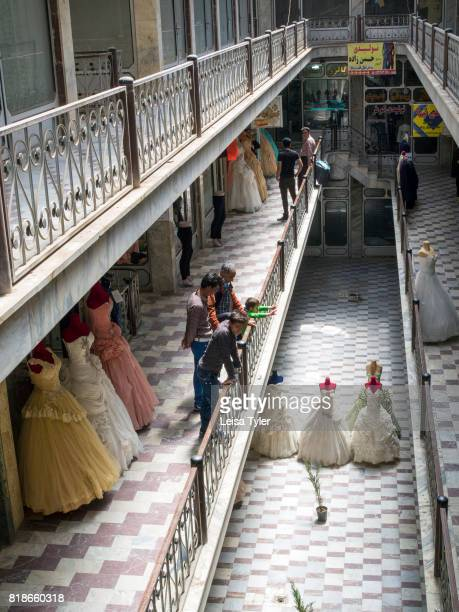 OLD CITY KASHAN ISFAHAN IRAN People socialising at the wedding gown section of Kashan Bazaar in Kashan Iran Kashan is one of the oldest inhabited...