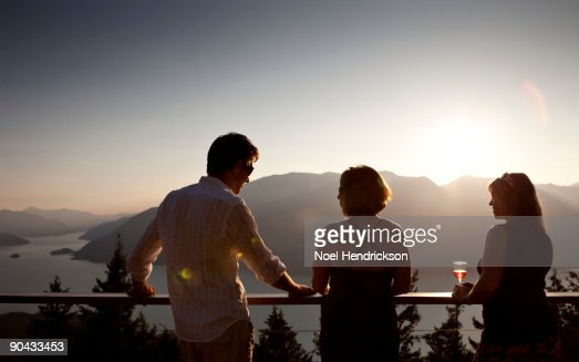 people socializing on deck, mountain view   : Stock Photo