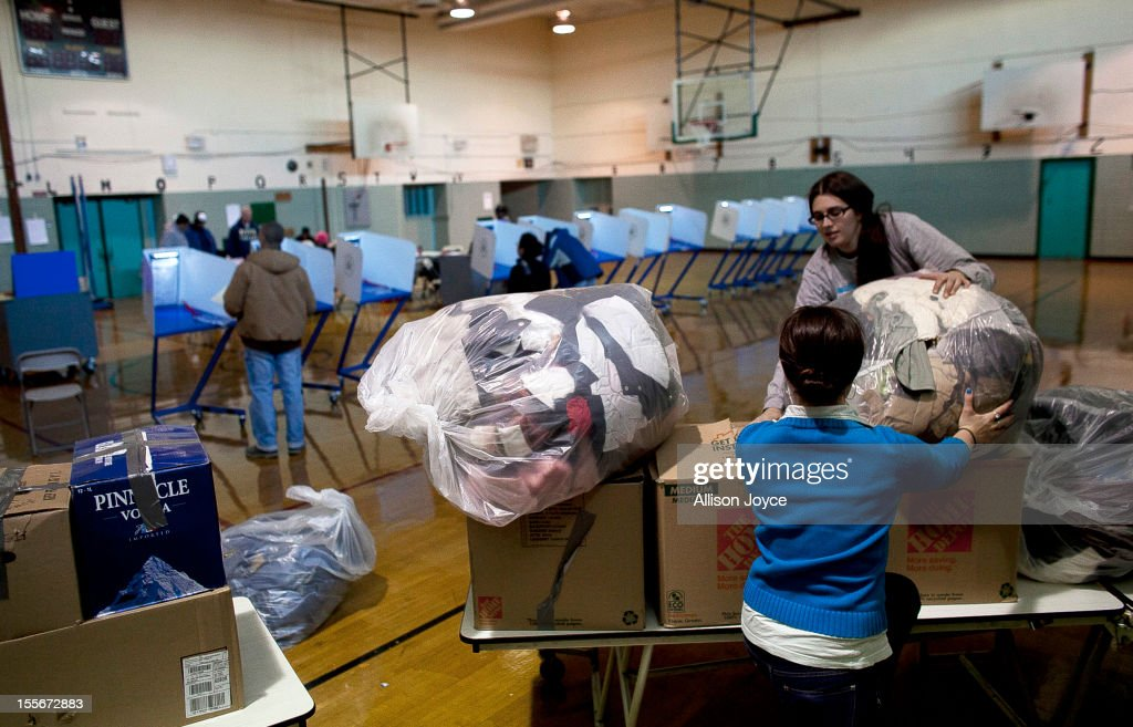People sort through donated goods at a polling center doubling as a donation site November 6, 2012 in the Staten Island borough of New York City. As Staten Island continues to recover from Superstorm Sandy, a few polling stations have been relocated due to power outages or ongoing use as an evacuation center.