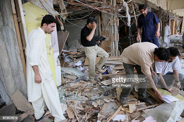 People sort through the rubble as recovery efforts continue after a suicide truck bombing outside the Marriott Hotel September 21 2008 in Islamabad...