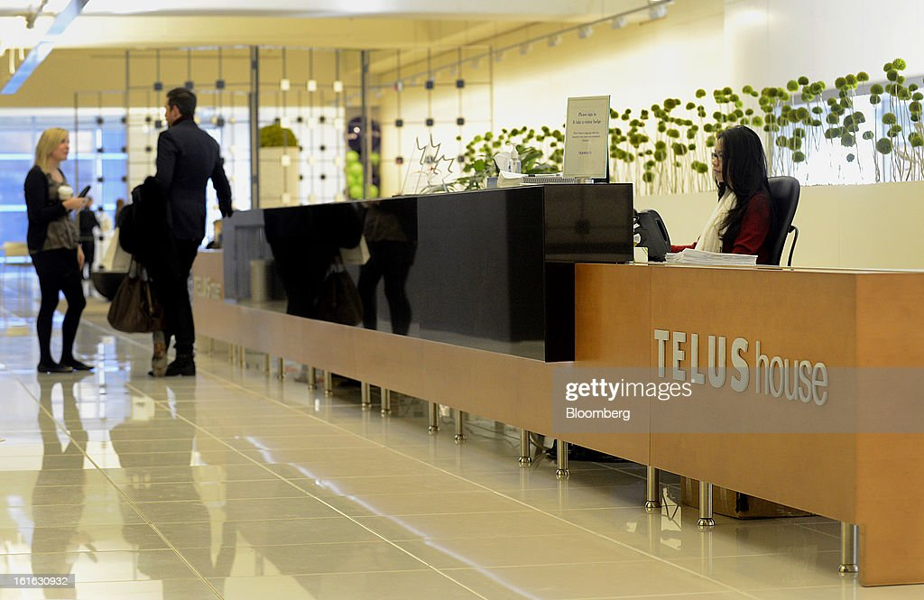 People speak in the lobby of the Telus Corp. office in Toronto, Ontario, Canada, on Wednesday, Feb. 13, 2013. Telus Corp. is scheduled to release earnings data on Feb. 15. Photographer: Aaron Harris/Bloomberg via Getty Images