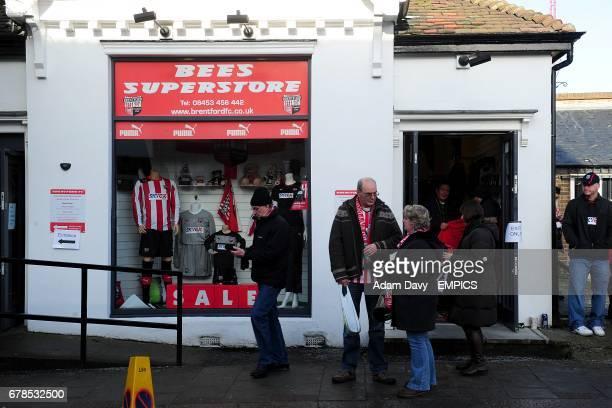 People speak outside the Brentford club shop before kickoff