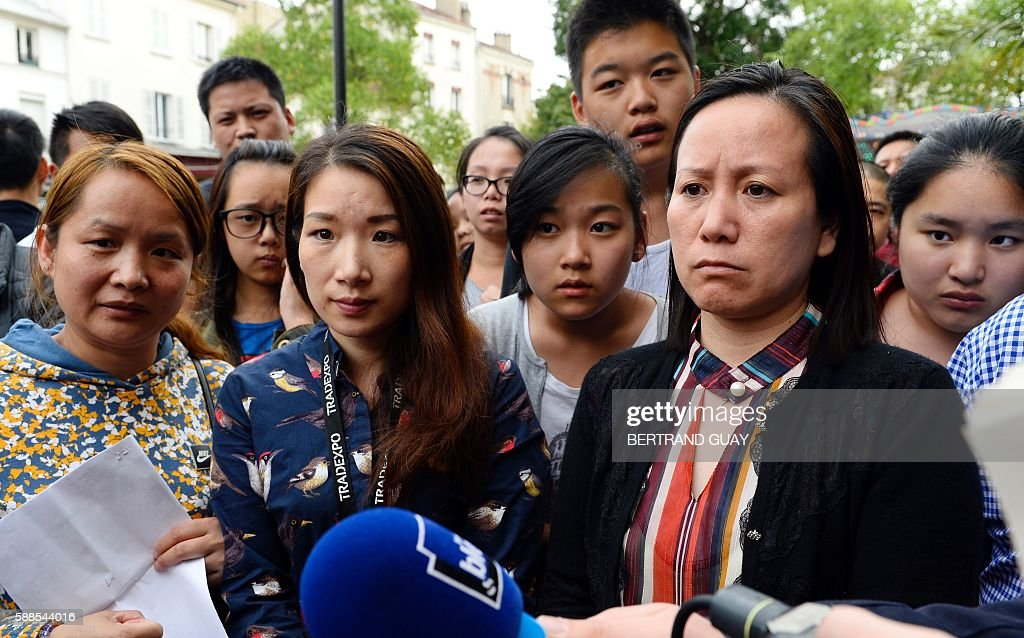 People speak to the medias on August 11 2016 in front of the city hall in Aubervilliers during a rally called by Aubervilliers' municipality asking...