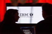 People speaks in front of IBM screen on November 14 2012 in Paris AFP PHOTO / FRED DUFOUR
