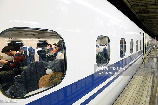 People spend a night in the Shinkansen bullet train waiting the service restart at JR Tokyo Station on January 4 2014 in Tokyo Japan A fire that...