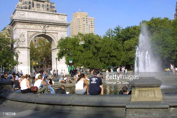 People spend the day at Washington Square Park the day after the World Trade Center disaster September 12 2001 in New York City