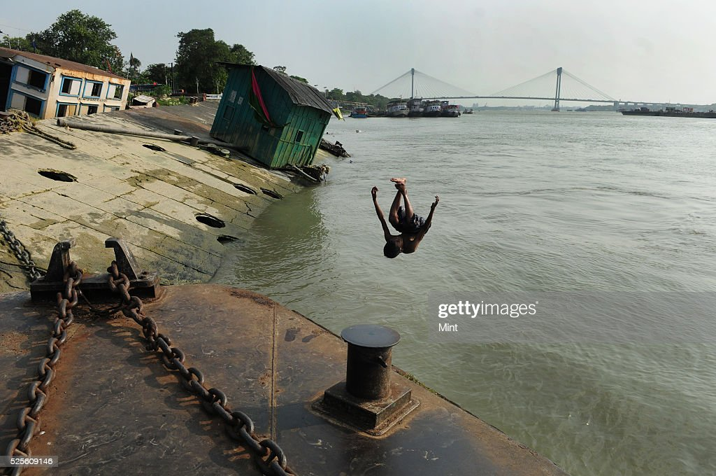 People spending time by swimming for hours in Ganges on a hot summer day on May 28, 2015 in Kolkata, India.