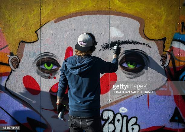 People spray color on a special made wall placed for Graffiti artists on October 2 2016 at Tantolunden park in Sodermalm Stockholm The wall in...