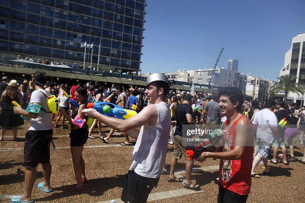 People spray water at each other during the annual water fight at Rabin Square July 5, 2013 in Tel Aviv, Israel. Hundreds of Israelis and tourists took part in this ninth annual water fight.