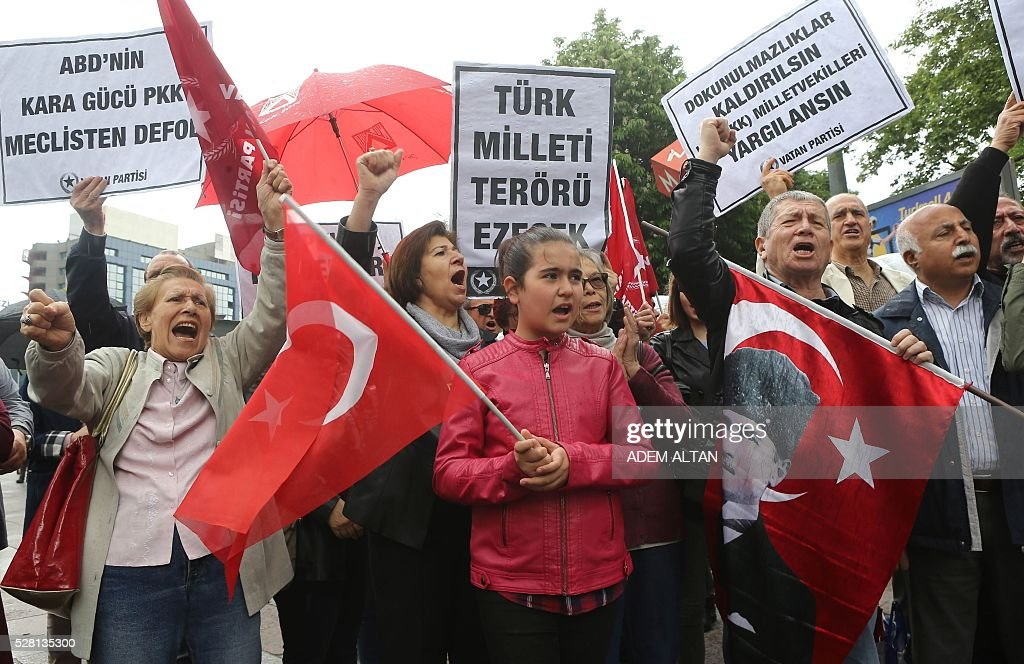People stage a demonstration in front of the Turkish Parliament in support of a bill to strip immunity of parliamentarians in Ankara on May 4, 2016. Banner reads 'we don't want suicide bombers (PKK) in the Parliament' and 'Turks will defeat Terrorism'. / AFP / ADEM