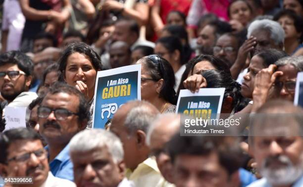 People stage a protest against the killing of senior journalist Gauri Lankesh at Town Hall on September 6 2017 in Bengaluru India Protests erupted...