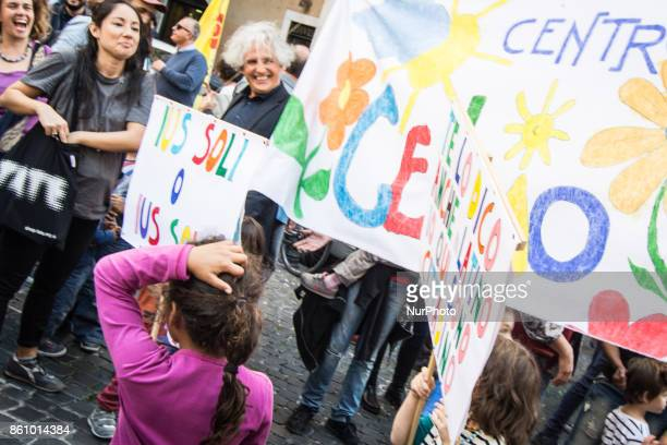 People stage a protest in support of the IUS SOLI law pro citizenship for children of migrants outside the Italian Parliament on 13 October 2017 in...