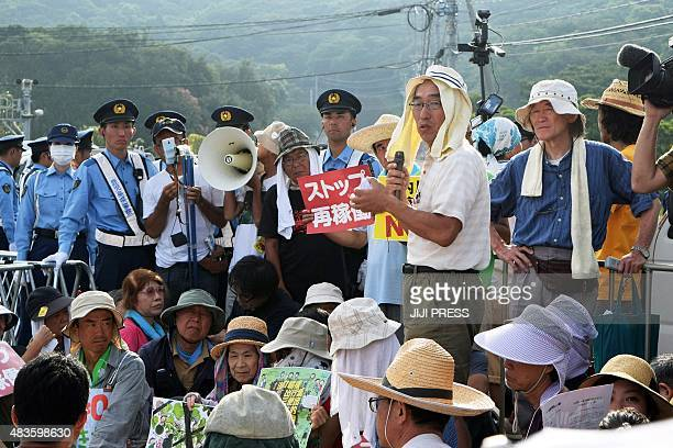 People stage a rally against the restarting of the nuclear reactor outside the gates of the Kyushu Electric Power Sendai nuclear power plant in...