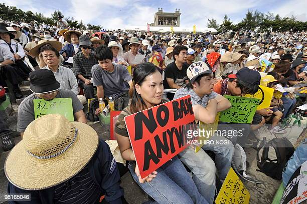 People stage a rally against the US military base in Ginowan Okinawa Prefecture on November 8 2009 Thousands rallied against a US military base on...