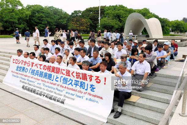 People stage a sitin protest against North Korea's nuclear test at Peace Memorial Park on September 4 2017 in Hiroshima Japan North Korean state news...