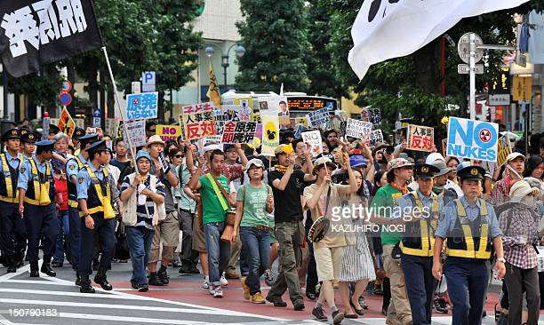 People stage an antinuclear demonstration march in Tokyo's shopping district Shibuya on August 26 2012 Some 200 protesters held an antinuclear...