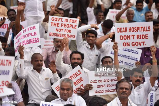 People staging demonstration in support of the amendment bill of Karnataka Private Medical Establishment Act at Town Hall on November 17 2017 in...