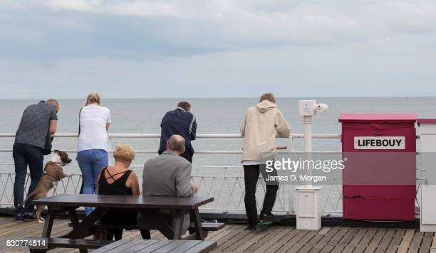 People stand at the end of the pier on August 12 2017 in Great Yarmouth England A cloudy overcast day greeted visitors to the Norfolk seaside town on...