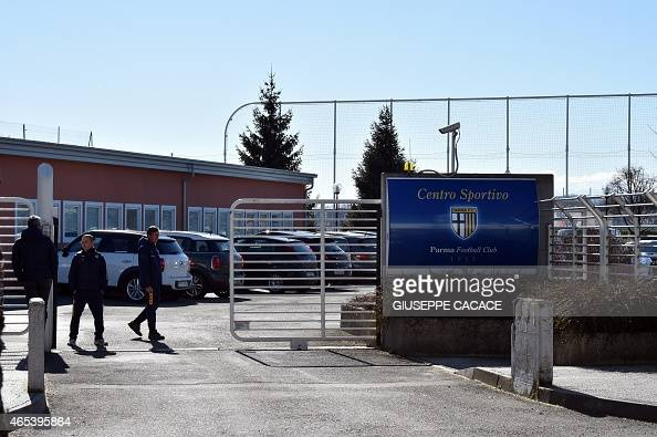 People stand at the entrance of the Parma FC training centre in Collecchio near Parma on March 6 2015 The Italian professional football league voted...