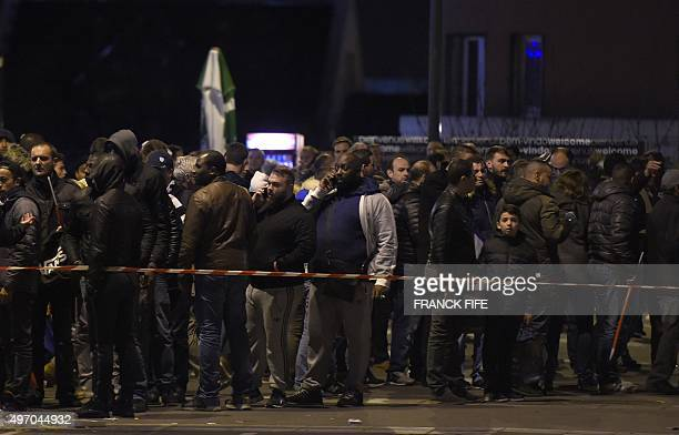 People stand behind a police cordon outside the Stade de France in SaintDenis north of Paris after the friendly football match France vs Germany on...