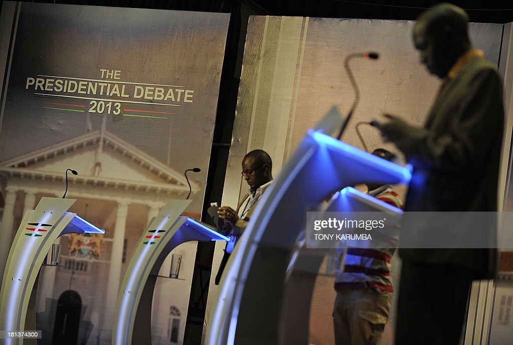 People stand behind pulpits during a presidential debate rehearsal on February 10, 2013 in the Kenyan capital Nairobi. Kenya's six presidential aspirants are expected to face-off in the country's first ever pre-election presidential debate amid fears of likely violence during the upcoming national elections. The risk of political violence in Kenya is 'perilously high' ahead of next month's election, the first since bloody post-poll violence five years ago, Human Rights Watch (HRW) warned.