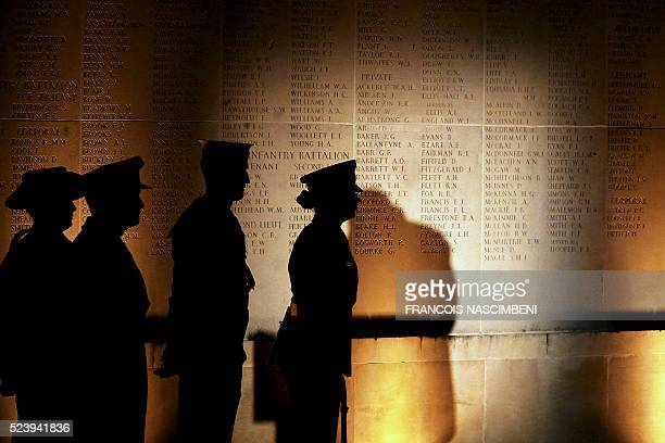 People stand by Australian Memorial of the World War I battle of the Somme in VillersBretonneux during the Anzac day in tribute of Australians and...